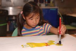 young girl painting a picture