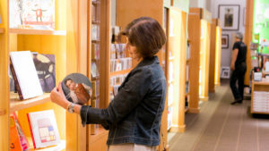 woman looking at merchandise in museum shop